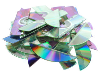 Destroyed CDs - shredded by a shredder.